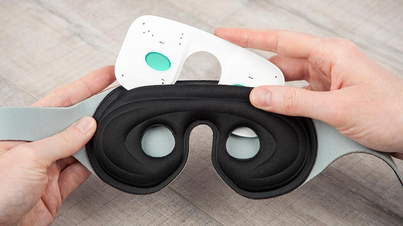 Before you go to sleep, touch the 'on' sensor to activate the pod. The green lights will become visible and you then slide the pod into the fabric mask